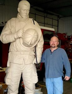 Scott and firefighter sculpture